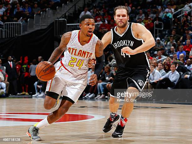 Kent Bazemore of the Atlanta Hawks drives against Bojan Bogdanovic of the Brooklyn Nets at Philips Arena on November 4 2015 in Atlanta Georgia NOTE...