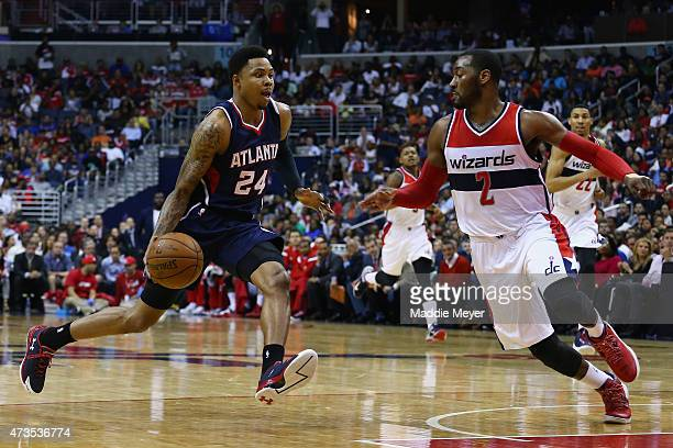 Kent Bazemore of the Atlanta Hawks drives against John Wall of the Washington Wizards during the second half at Verizon Center on May 15 2015 in...