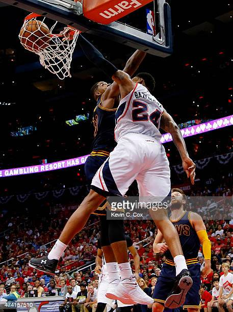 Kent Bazemore of the Atlanta Hawks dunks against Tristan Thompson of the Cleveland Cavaliers in the third quarter during Game One of the Eastern...