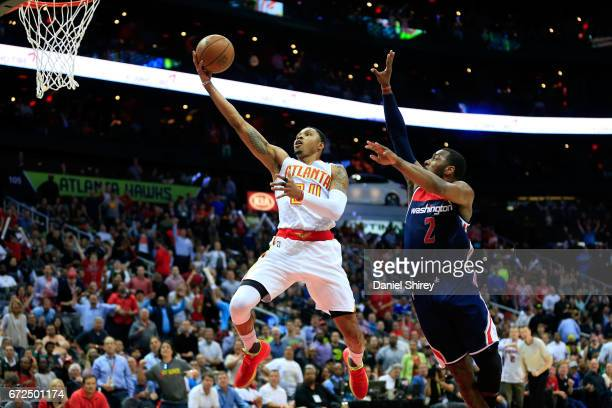 Kent Bazemore of the Atlanta Hawks goes up for a basket against John Wall of the Washington Wizards during the second quarter in Game Four of the...