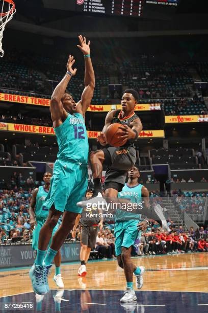 Kent Bazemore of the Atlanta Hawks looks to pass against the Charlotte Hornets on October 20 2017 at Spectrum Center in Charlotte North Carolina NOTE...