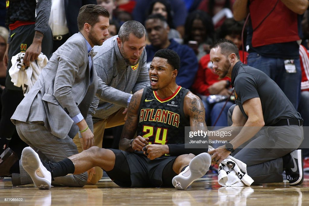 Kent Bazemore #24 of the Atlanta Hawks reacts after getting injured on a play during the second half of a game against the New Orleans Pelicans at the Smoothie King Center on November 13, 2017 in New Orleans, Louisiana.