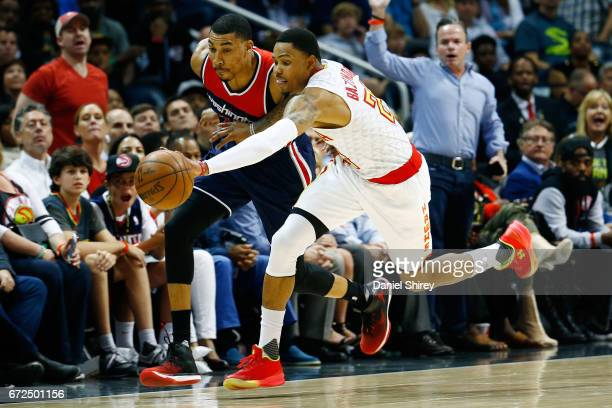 Kent Bazemore of the Atlanta Hawks steals the ball from Otto Porter Jr #22 of the Washington Wizards during the second quarter in Game Four of the...
