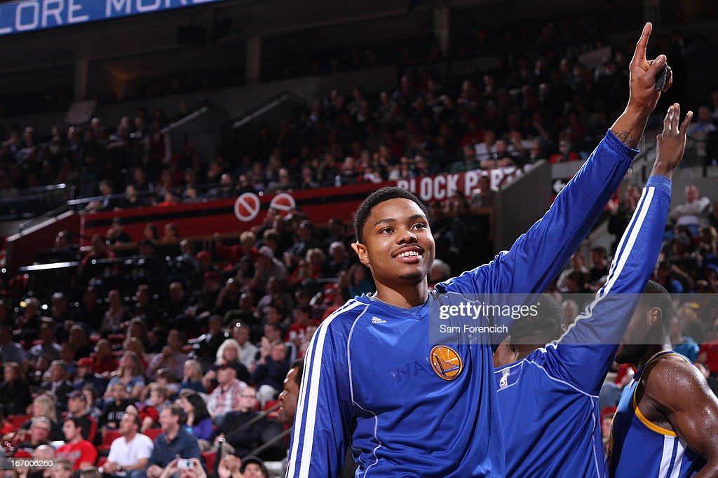 <a gi-track='captionPersonalityLinkClicked' href=/galleries/search?phrase=Kent+Bazemore&family=editorial&specificpeople=6846101 ng-click='$event.stopPropagation()'>Kent Bazemore</a> #20 of the Golden State Warriors celebrates before the game against the Portland Trail Blazers on April 17, 2013 at the Rose Garden Arena in Portland, Oregon.