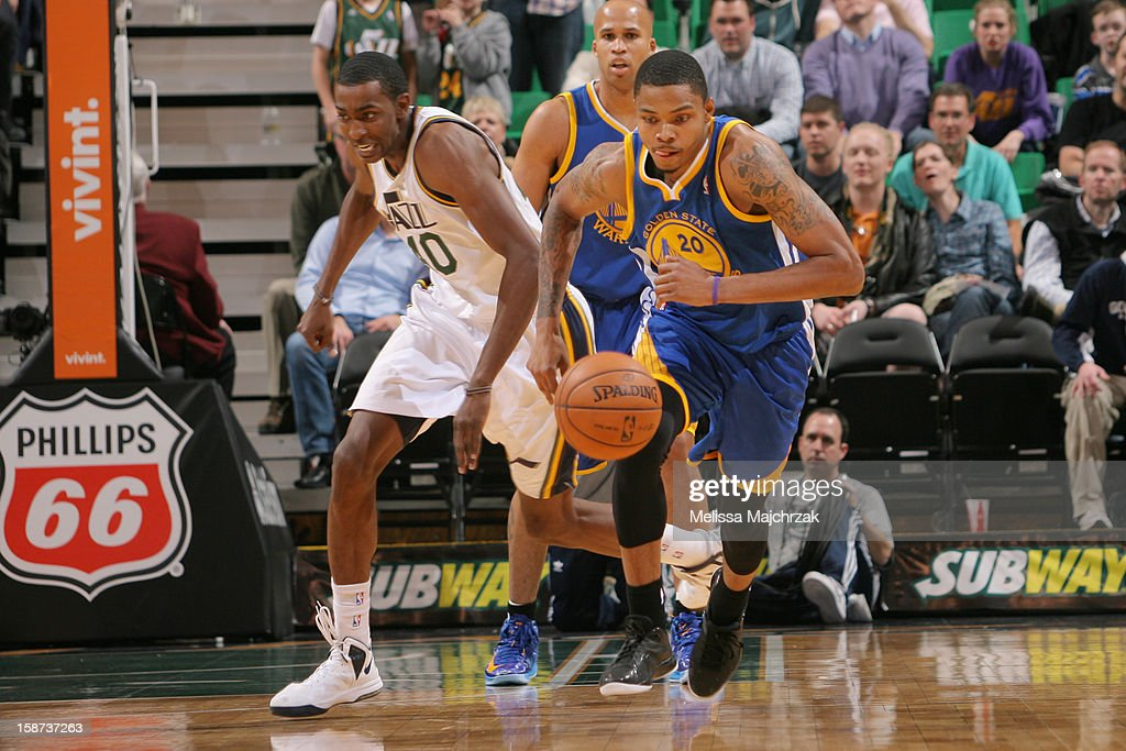 <a gi-track='captionPersonalityLinkClicked' href=/galleries/search?phrase=Kent+Bazemore&family=editorial&specificpeople=6846101 ng-click='$event.stopPropagation()'>Kent Bazemore</a> #20 of the Golden State Warriors chases down a loose ball against Jeremy Evans #40 of the Utah Jazz at Energy Solutions Arena on December 26, 2012 in Salt Lake City, Utah.