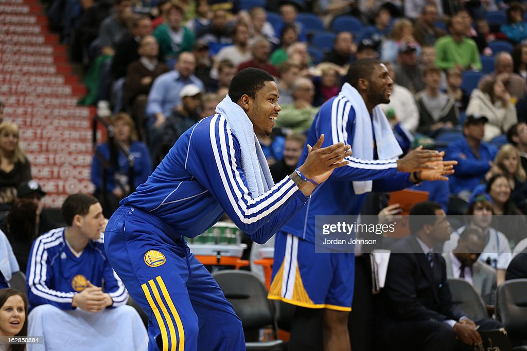 <a gi-track='captionPersonalityLinkClicked' href=/galleries/search?phrase=Kent+Bazemore&family=editorial&specificpeople=6846101 ng-click='$event.stopPropagation()'>Kent Bazemore</a> #20 of the Golden State Warriors claps from the bench during the game against the Minnesota Timberwolves on February 24, 2013 at Target Center in Minneapolis, Minnesota.