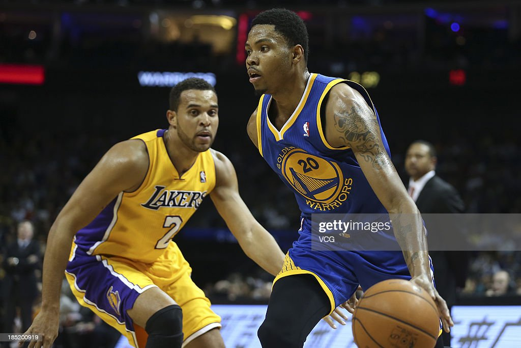<a gi-track='captionPersonalityLinkClicked' href=/galleries/search?phrase=Kent+Bazemore&family=editorial&specificpeople=6846101 ng-click='$event.stopPropagation()'>Kent Bazemore</a> #20 of the Golden State Warriors drives the ball against <a gi-track='captionPersonalityLinkClicked' href=/galleries/search?phrase=Elias+Harris&family=editorial&specificpeople=6164446 ng-click='$event.stopPropagation()'>Elias Harris</a> #2 of the Los Angeles Lakers during the 2013 Global Games at the Mercedes-Benz Arena on October 18, 2013 in Shanghai, China.