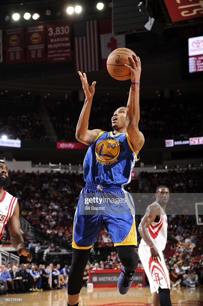 <a gi-track='captionPersonalityLinkClicked' href=/galleries/search?phrase=Kent+Bazemore&family=editorial&specificpeople=6846101 ng-click='$event.stopPropagation()'>Kent Bazemore</a> #20 of the Golden State Warriors drives to the basket against the Houston Rockets on February 5, 2013 at the Toyota Center in Houston, Texas.