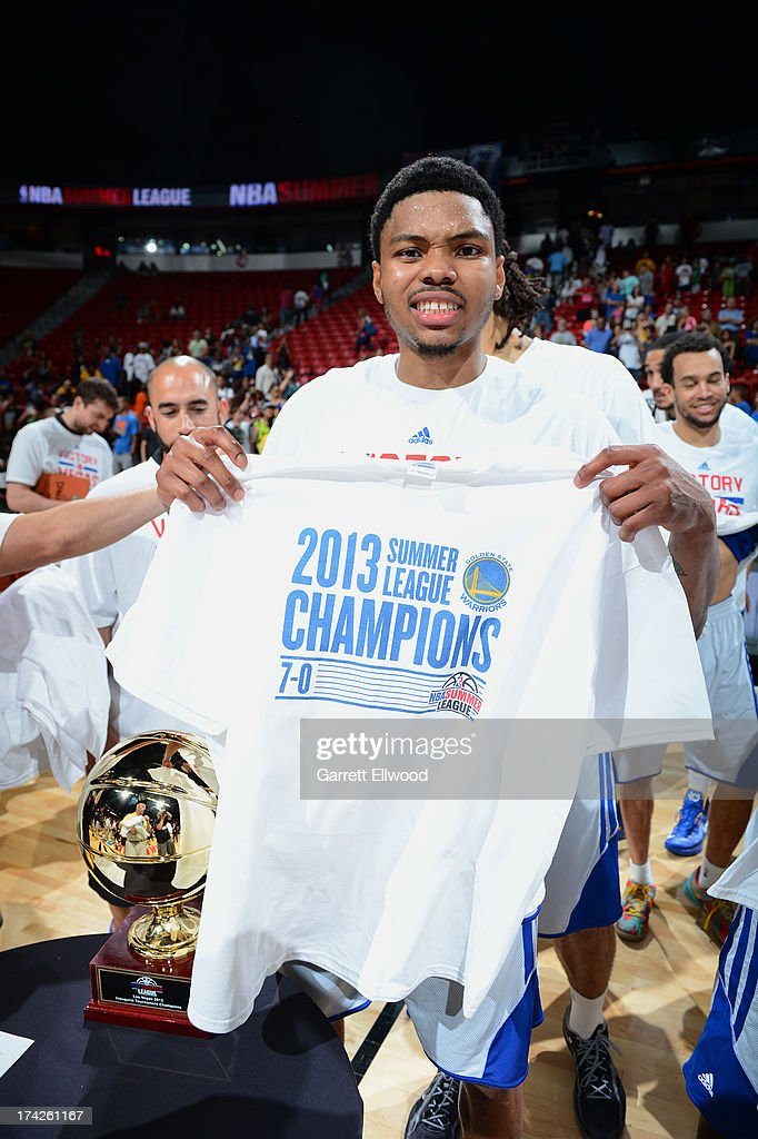 Kent Bazemore #20 of the Golden State Warriors holds up his summer league championship tee-shirt against the Phoenix Suns during NBA Summer League Championship Game on July 22, 2013 at the Cox Pavilion in Las Vegas, Nevada.