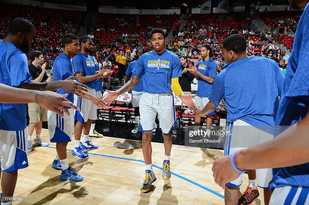 Kent Bazemore #20 of the Golden State Warriors is greeted by teammates during NBA Summer League game between the Charlotte Bobcats and the Golden State Warriors on July 21, 2013 at the Cox Pavilion in Las Vegas, Nevada.