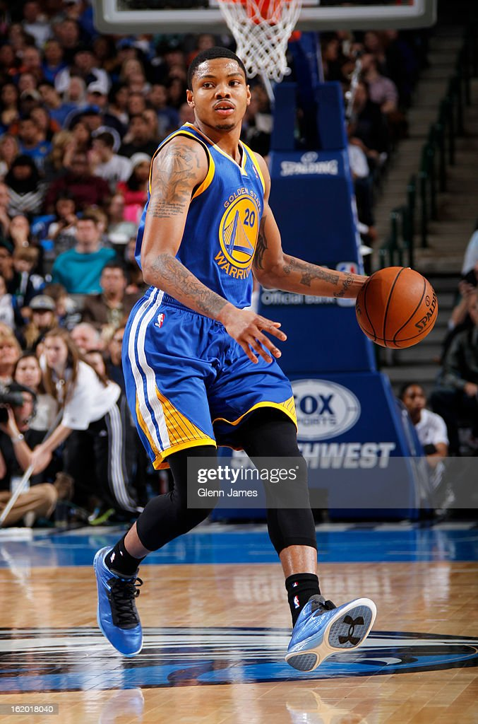 <a gi-track='captionPersonalityLinkClicked' href=/galleries/search?phrase=Kent+Bazemore&family=editorial&specificpeople=6846101 ng-click='$event.stopPropagation()'>Kent Bazemore</a> #20 of the Golden State Warriors looks to pass the ball against the Dallas Mavericks on February 9, 2013 at the American Airlines Center in Dallas, Texas.
