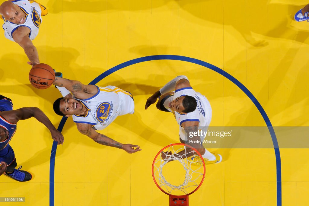 <a gi-track='captionPersonalityLinkClicked' href=/galleries/search?phrase=Kent+Bazemore&family=editorial&specificpeople=6846101 ng-click='$event.stopPropagation()'>Kent Bazemore</a> #20 of the Golden State Warriors rebounds against the New York Knicks on March 11, 2013 at Oracle Arena in Oakland, California.
