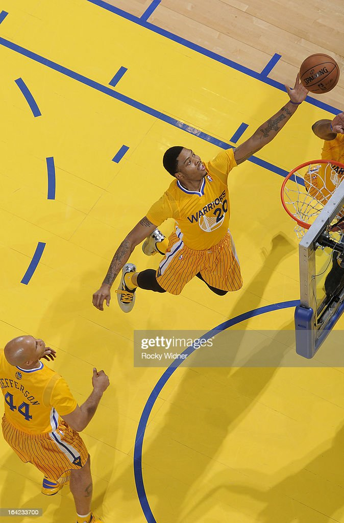 <a gi-track='captionPersonalityLinkClicked' href=/galleries/search?phrase=Kent+Bazemore&family=editorial&specificpeople=6846101 ng-click='$event.stopPropagation()'>Kent Bazemore</a> #20 of the Golden State Warriors rebounds against the Chicago Bulls on March 15, 2013 at Oracle Arena in Oakland, California.