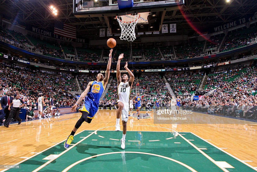 Kent Bazemore #20 of the Golden State Warriors shoots a layup on a fast break against Alec Burks #10 of the Utah Jazz at Energy Solutions Arena on February 19, 2013 in Salt Lake City, Utah.