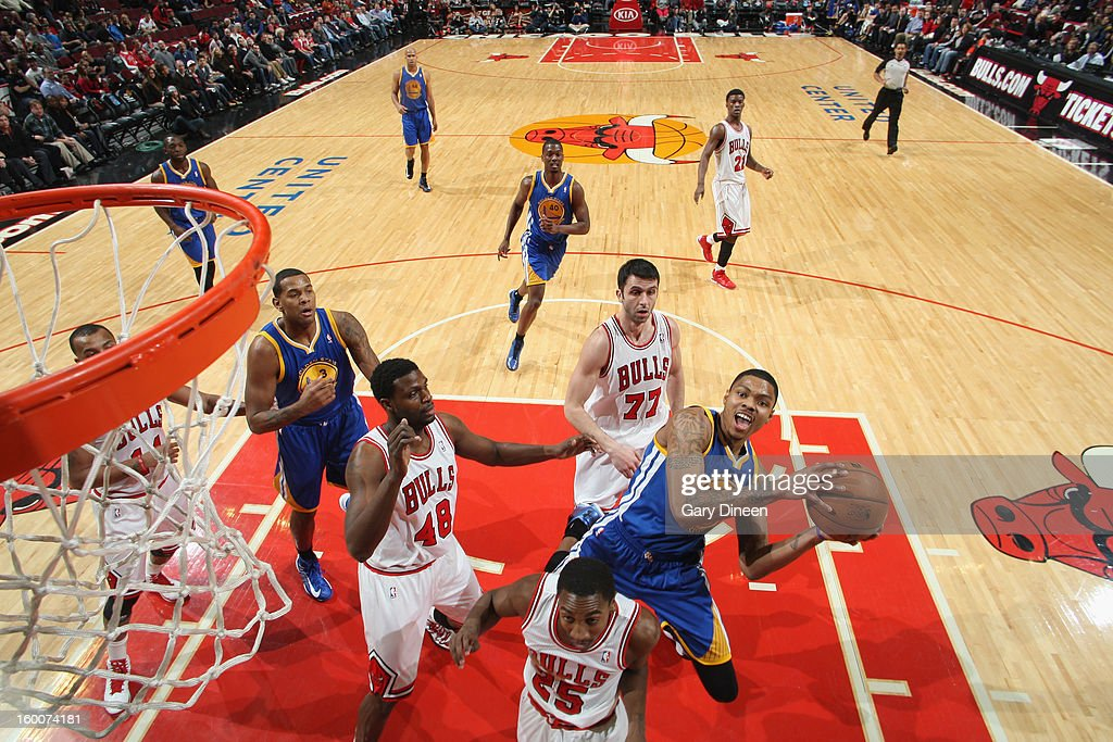 Kent Bazemore #20 of the Golden State Warriors shoots against (L-R) Nazr Mohammed #48, Marquis Teague #25 and Vladimir Radmanovic #77 of the Chicago Bulls on January 25, 2012 at the United Center in Chicago, Illinois.
