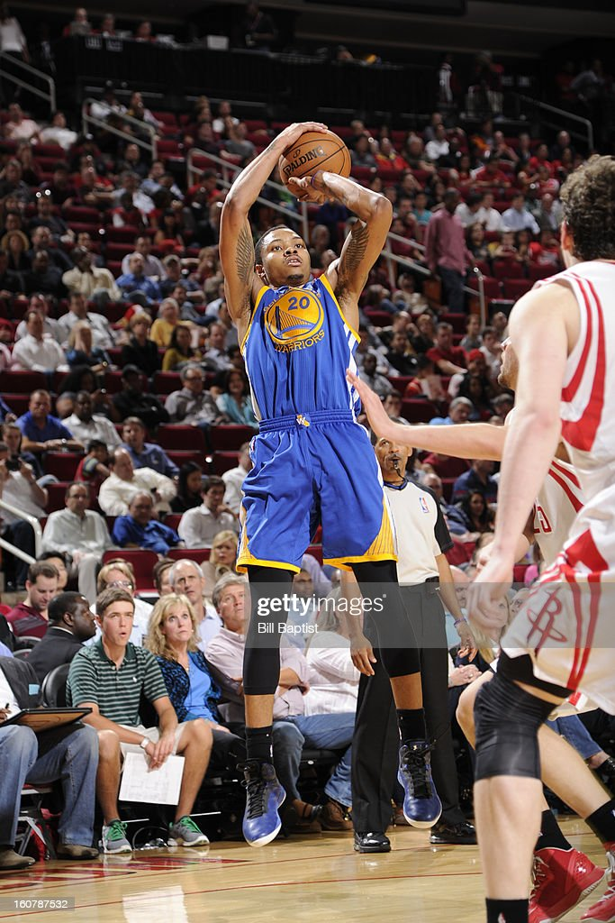 Kent Bazemore #20 of the Golden State Warriors shoots the ball against the Houston Rockets on February 5, 2013 at the Toyota Center in Houston, Texas.