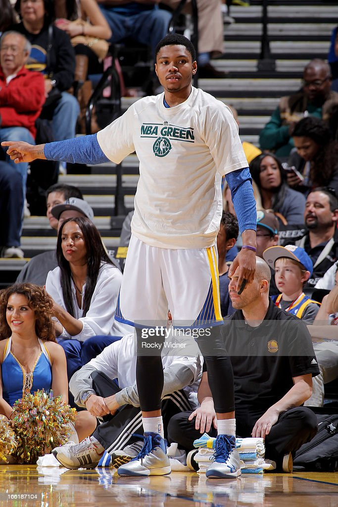 Kent Bazemore #20 of the Golden State Warriors, wearing an NBA Green Week T-shirt, cheers his teammates on from the sideline during a game against Minnesota Timberwolves on April 9, 2013 at Oracle Arena in Oakland, California.