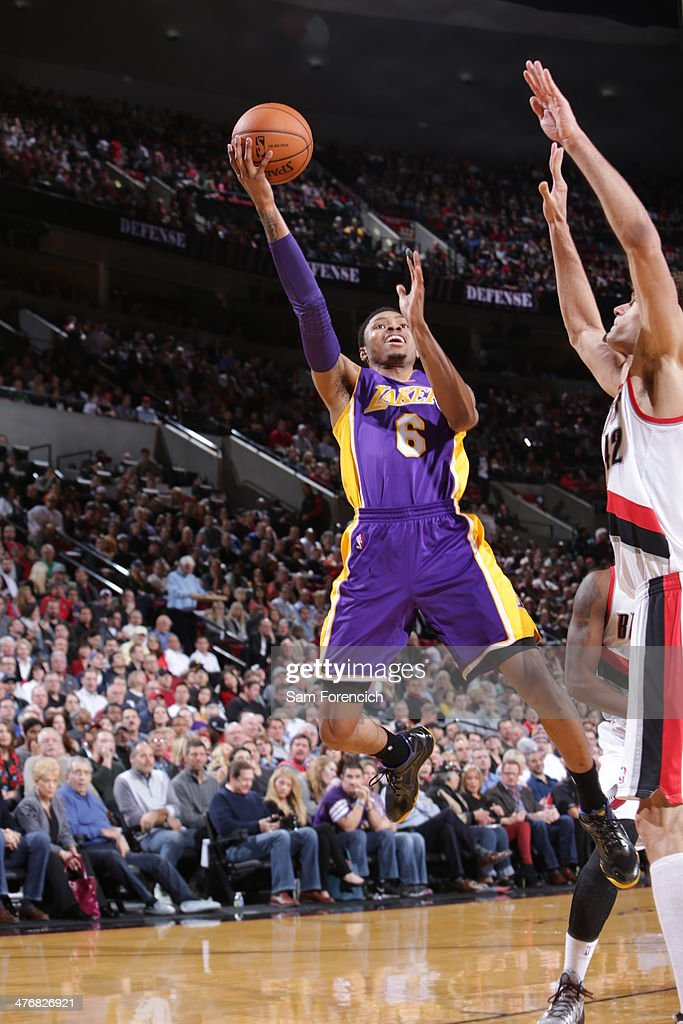<a gi-track='captionPersonalityLinkClicked' href=/galleries/search?phrase=Kent+Bazemore&family=editorial&specificpeople=6846101 ng-click='$event.stopPropagation()'>Kent Bazemore</a> #6 of the Los Angeles Lakers drives to the basket against the Portland Trail Blazers on March 3, 2014 at the Moda Center Arena in Portland, Oregon.