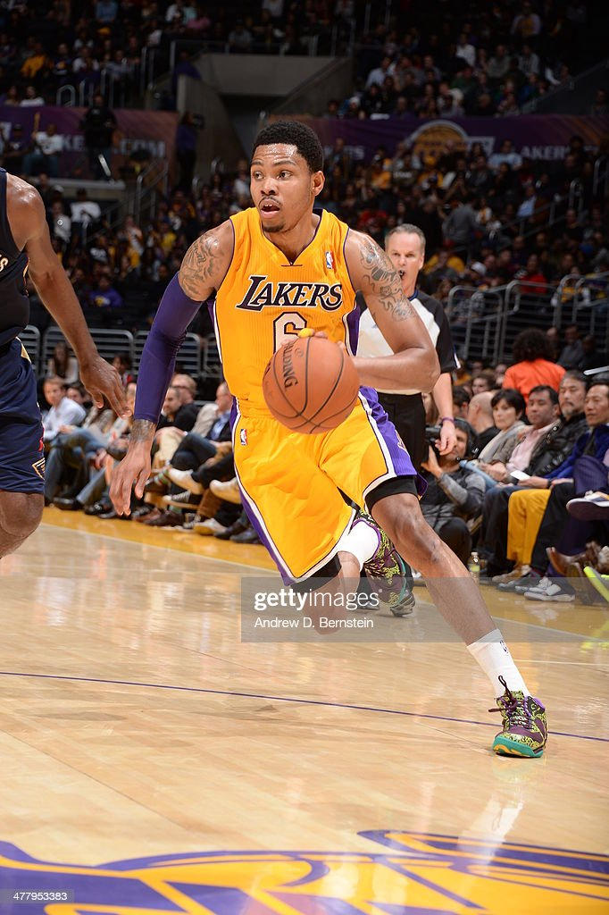 <a gi-track='captionPersonalityLinkClicked' href=/galleries/search?phrase=Kent+Bazemore&family=editorial&specificpeople=6846101 ng-click='$event.stopPropagation()'>Kent Bazemore</a> #6 of the Los Angeles Lakers handles the ball against the New Orleans Pelicans at Staples Center on March 4, 2014 in Los Angeles, California.