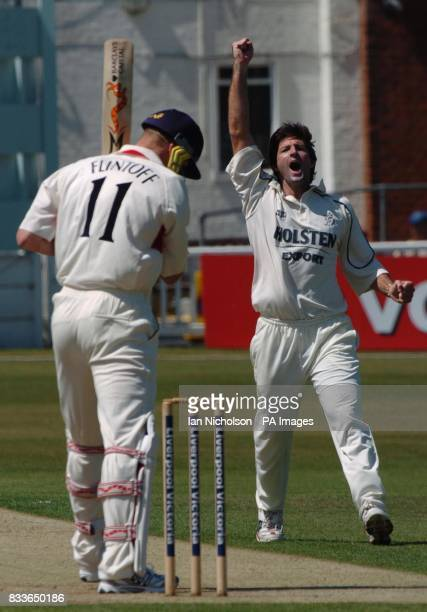 Kent bowler Tyrone Henderson celebrates as Lancashire's Andrew Flintoff is dismissed for 4 runs during the Liverpool Victoria County Championship...