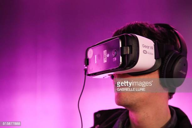 Kent Bye of Voices of VR wears Oculus goggles while testing out the Minecraft for Gear VR at The Village event space in San Francisco California on...