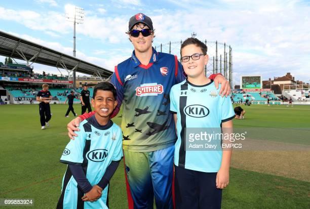 Kent Captain Sam Northeast poses with young mascots prior to the match