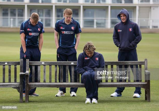 Kent cricketers Alex Blake Adam Riley Michael Powell and Adam Ball try to keep warm in freezing conditions as the players prepare to pose for a team...