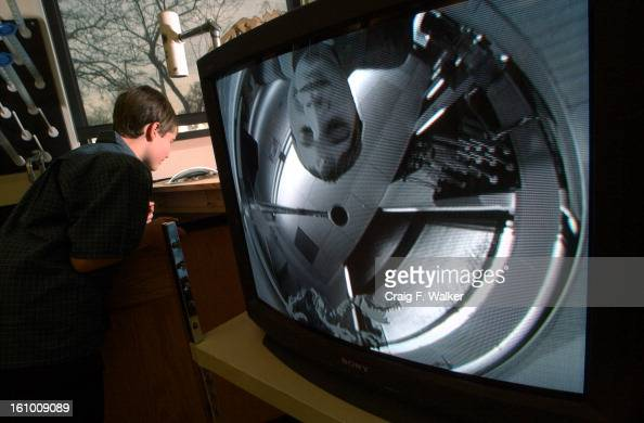 Kent Denver 7th grader David Julia is viewed on a monitor as he examines the convex mirror of the schools All Sky camera A state wide space science...