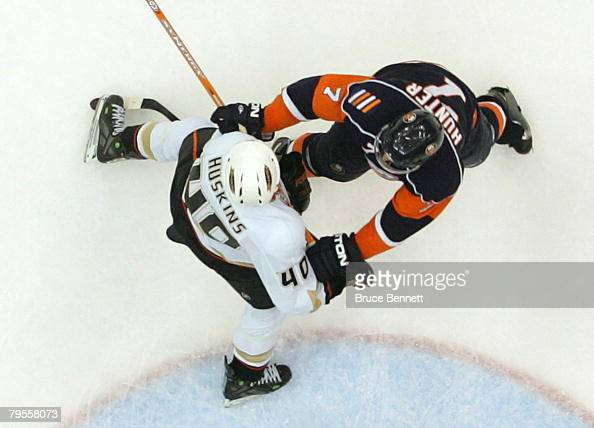 Kent Huskins of the Anaheim Ducks and Trent Hunter of the New York Islanders jostle for position on February 5 2008 at the Nassau Coliseum in...