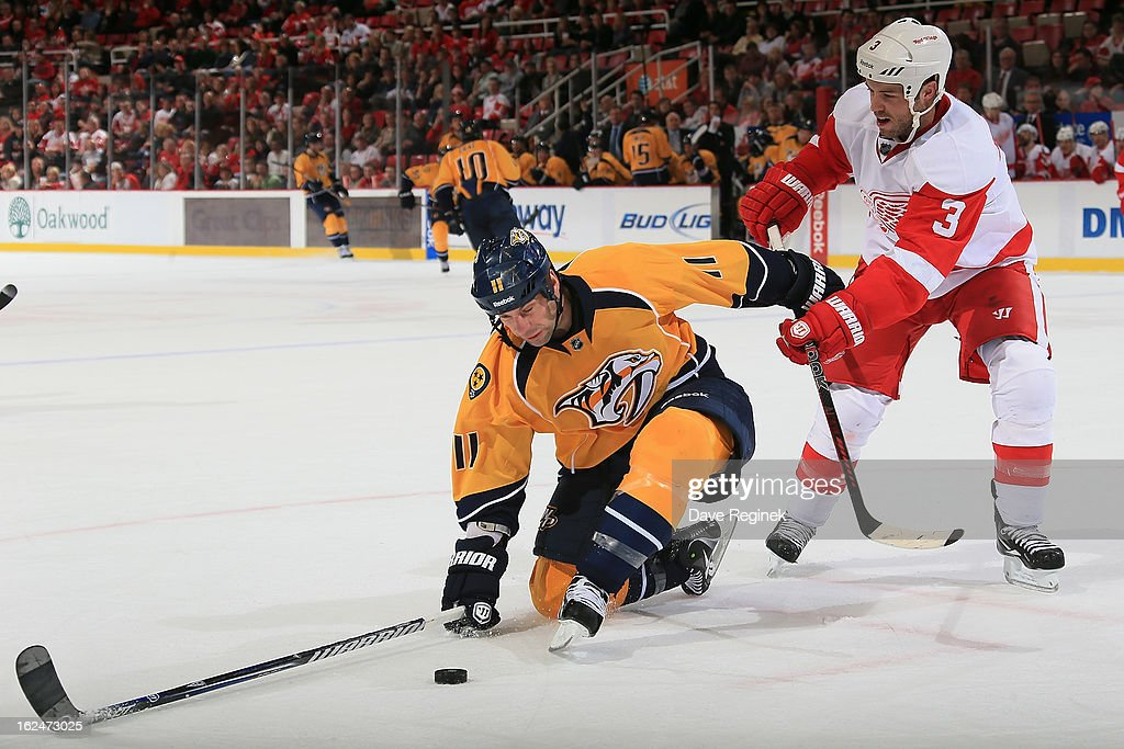 <a gi-track='captionPersonalityLinkClicked' href=/galleries/search?phrase=Kent+Huskins&family=editorial&specificpeople=2190963 ng-click='$event.stopPropagation()'>Kent Huskins</a> #3 of the Detroit Red Wings checks <a gi-track='captionPersonalityLinkClicked' href=/galleries/search?phrase=David+Legwand&family=editorial&specificpeople=202553 ng-click='$event.stopPropagation()'>David Legwand</a> #11 of the Nashville Predators during a NHL game at Joe Louis Arena on February 23, 2013 in Detroit, Michigan. The Wings won 4-0