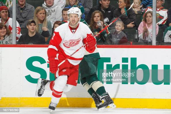 Kent Huskins of the Detroit Red Wings skates against the Minnesota Wild during the game on February 17 2013 at the Xcel Energy Center in Saint Paul...