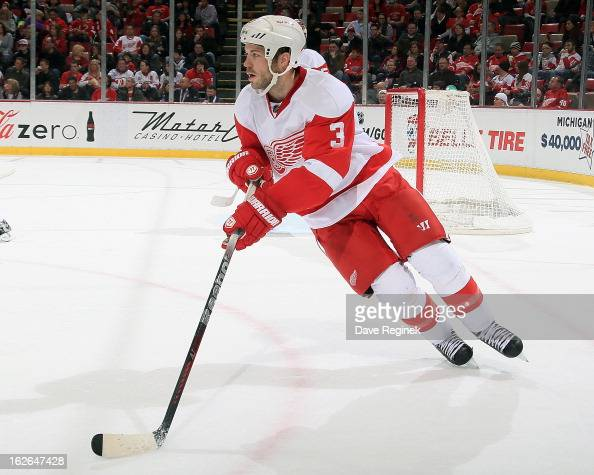 Kent Huskins of the Detroit Red Wings skates with the puck during a NHL game against the Nashville Predators at Joe Louis Arena on February 23 2013...