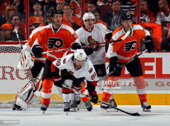 Kent Huskins of the Philadelphia Flyers hits Cory Conacher of the Ottawa Senators in front of the Flyers net at the Wells Fargo Center on April 11...