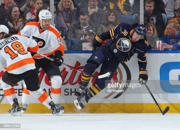 Kent Huskins of the Philadelphia Flyers upends Patrick Kaleta of the Buffalo Sabres along the boards on April 13 2013 at the First Niagara Center in...