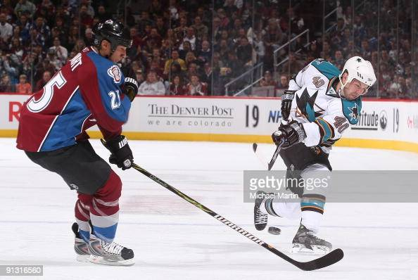 Kent Huskins of the San Jose Sharks skates against Chris Stewart of the Colorado Avalanche on the home opener at the Pepsi Center on October 1 2009...