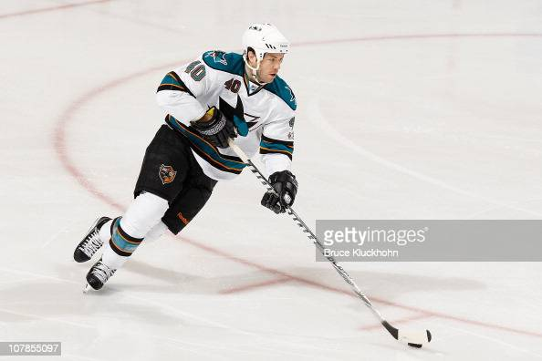 Kent Huskins of the San Jose Sharks skates with the puck against the Minnesota Wild during the game at the Xcel Energy Center on December 29 2010 in...
