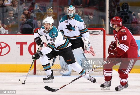 Kent Huskins of the San Jose Sharks skates with the puck during the NHL game against the Phoenix Coyotes at Jobingcom Arena on January 17 2011 in...
