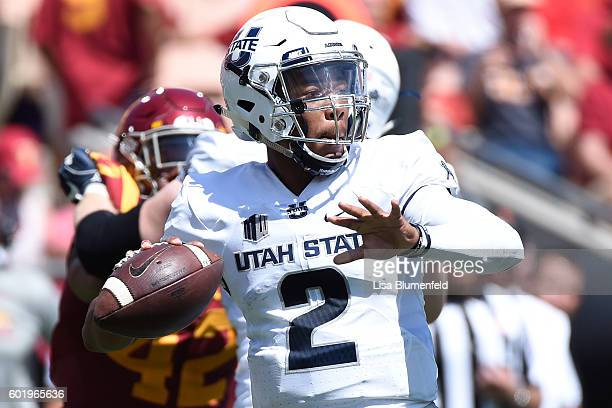 Kent Myers of the Utah State Aggies looks to pass in the first quarter against the USC Trojans at Los Angeles Coliseum on September 10 2016 in Los...