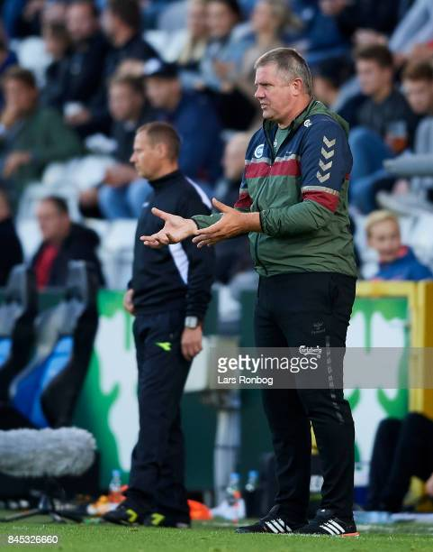 Kent Nielsen head coach of OB Odense gestures during the Danish Alka Superliga match between OB Odense and Brondby IF at EWII Park on September 10...