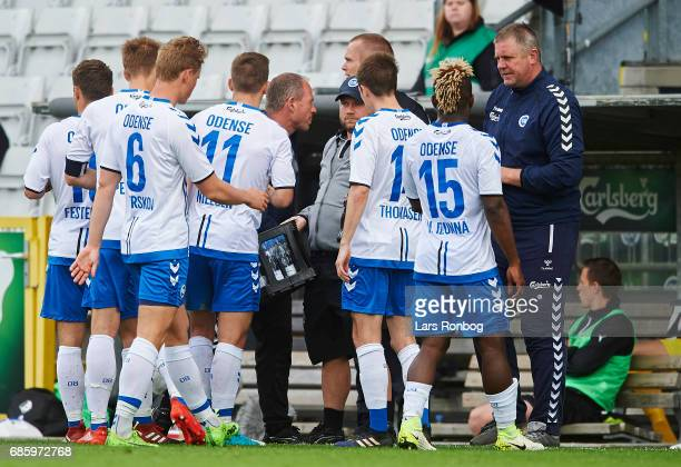 Kent Nielsen head coach of OB Odense speaks to his players during the Danish Alka Superliga match between OB Odense and Randers FC at EWII Park on...