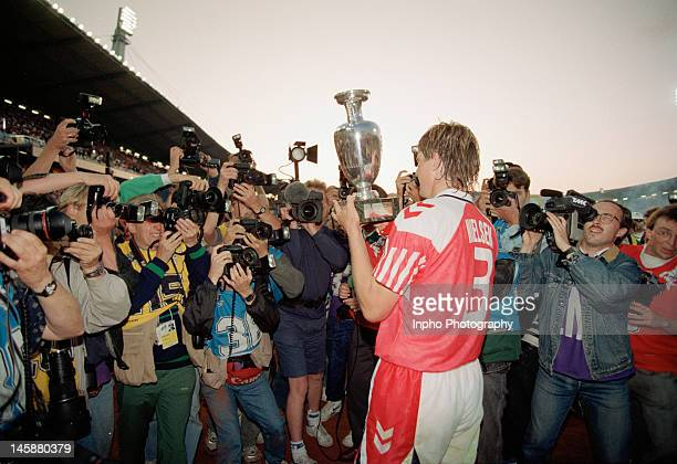 Kent Nielsen of Denmark lifts the trophy after the UEFA European Championships 1992 Final between Denmark and Germany held at the Ullevi Stadium on...