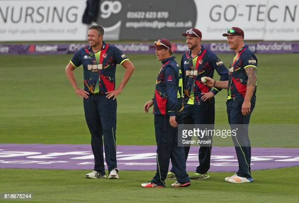 Kent Spitfires players Mitchell Claydon Sam Northeast Alex Blake and Matt Coles celebrate after the run out of Gloucestershire's Benny Howell during...