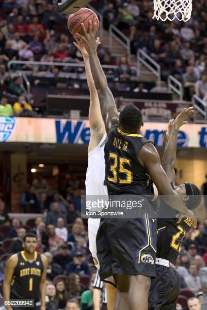 Kent State Golden Flashes F Jimmy Hall blocks the shot of Ohio Bobcats G/F Gavin Block during the first half of the MAC mens basketball tournament...