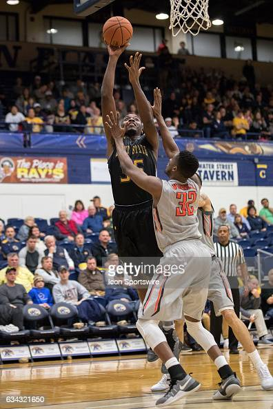 Kent State Golden Flashes F Jimmy Hall shoots over Bowling Green Falcons F Rasheed Worrell during the second half of the men's college basketball...