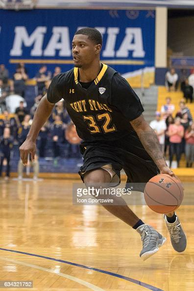 Kent State Golden Flashes G Desmond Ridenour drives to the basket during the second half of the men's college basketball game between the Bowling...