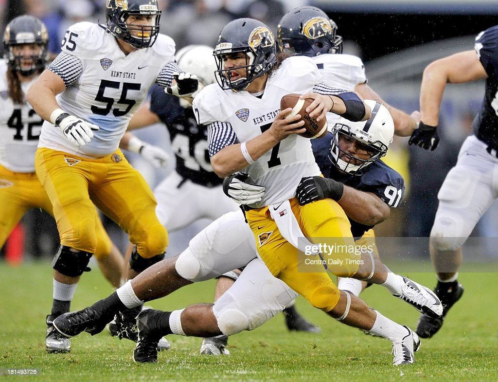 Kent State's David Fisher is taken down by Penn State's DaQuan Jones during a college football game at Beaver Stadium in State College, Pennsylvania, on Saturday, September 21, 2013.