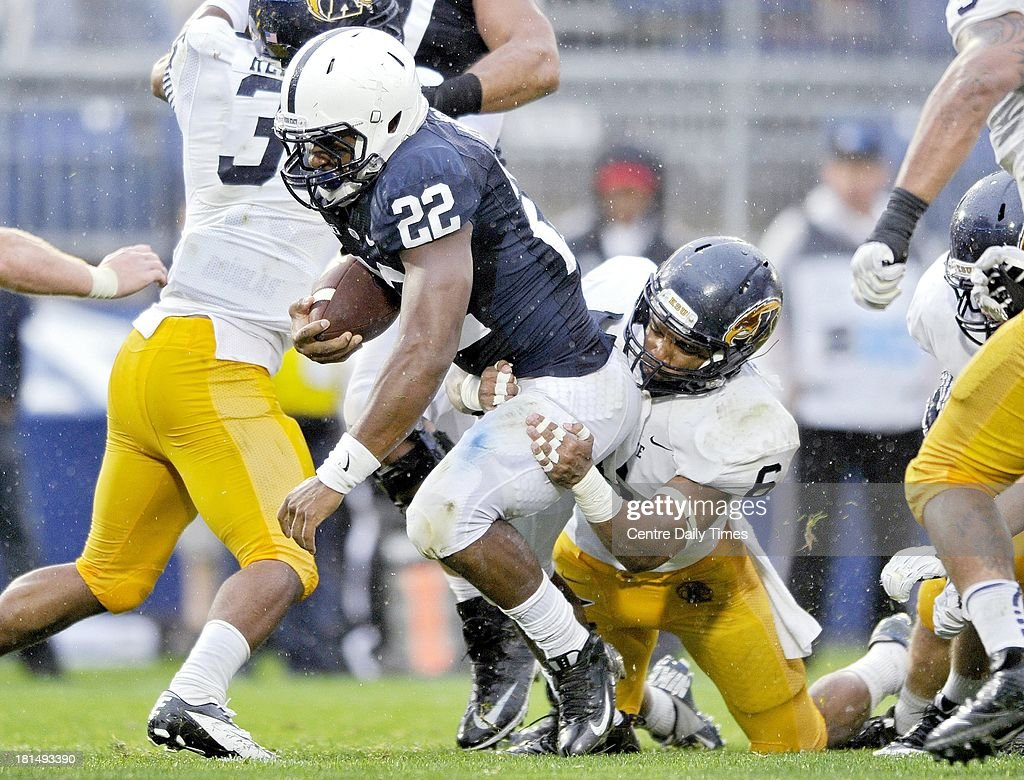 Kent State's Keenan Stalls tries to stop Penn State's Akeel Lynch during a college football game at Beaver Stadium in State College, Pennsylvania, on Saturday, September 21, 2013.