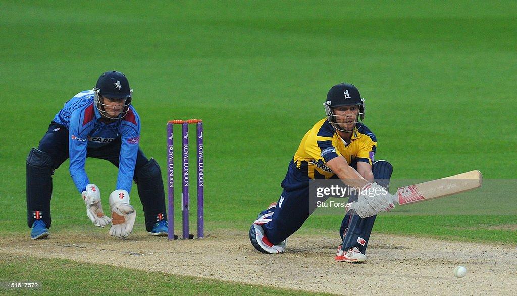 Kent wicketkeeper Sam Billings looks on as Warwickshire batsman Jonathan Trott reverse sweeps a ball towards the boundary during the Royal London...