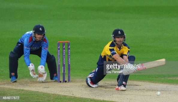 Kent wicketkeeper Sam Billings looks on as Warwickshire batsman Jonathan Trott reverse sweeps a ball towards the boundary during the Royal London...