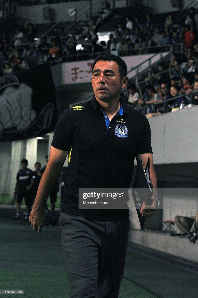 Kenta Hasegawa,coach of Gamba Osaka looks on during the J.League second division match between JEF United Chiba and Gamba Osaka at Fukuda Denshi Arena on July 7, 2013 in Chiba, Japan.